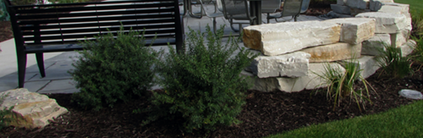 commercial hardscape with bench and retaining wall