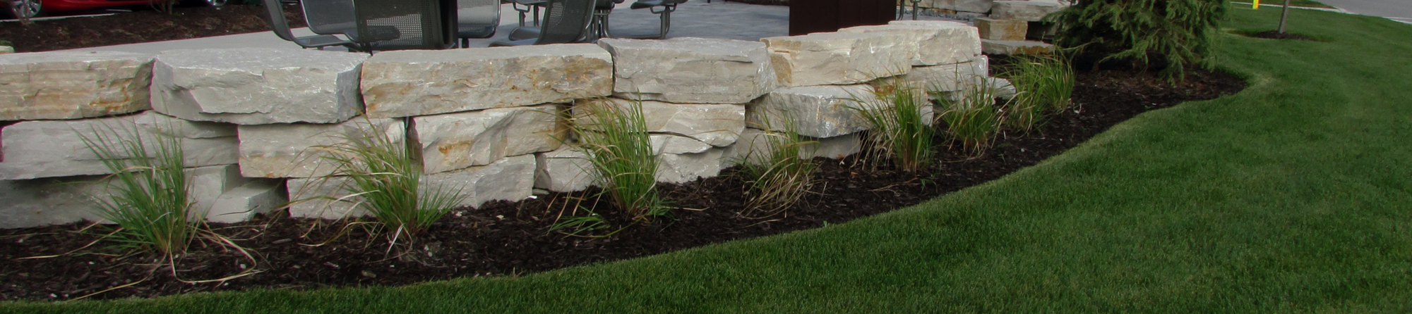 commercial retaining wall landscaped